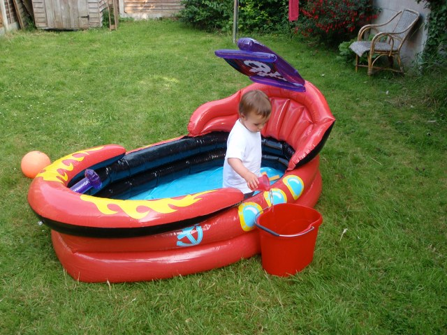 Hugh in our back garden earlier this evening, helping to empty his new paddling pool.