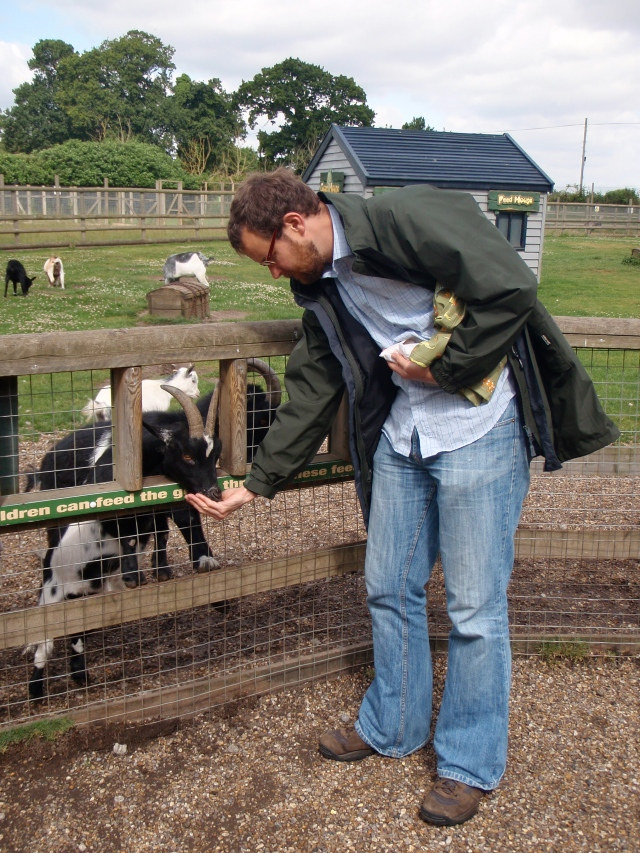 Shift of scene to Reedham, Norfolk - Ken feeds one of a number of extremely forward goats at Pettit's