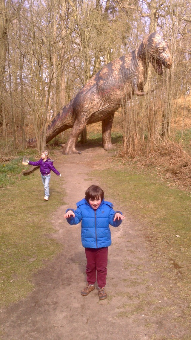 Hugh poses a safe distance back from the dinosaur